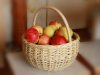 round basket with apples